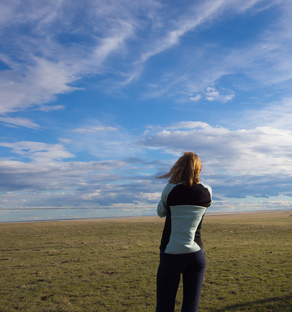 Lynn shooting the great cloudscapes we were seeing on the drive back that evening.