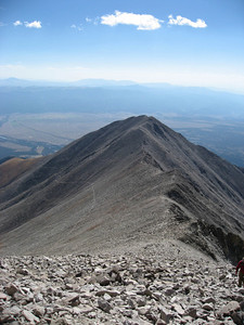 You can clearly see the trail (including the old mining trail) traversing the side of Tigger (which is the 13er in the distance). The new trail cuts up sooner and traverses the ridge more.