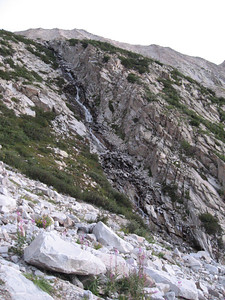 A waterfall to the right of the scree gully.