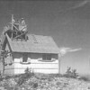 """The website <A HREF=""""http://www.firelookout.com/or/redhillgs.html"""">firelookout.com</A> has this photo of the old Red Hill Guard Station posted."""