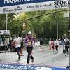 Chiyoko crosses the finish line.