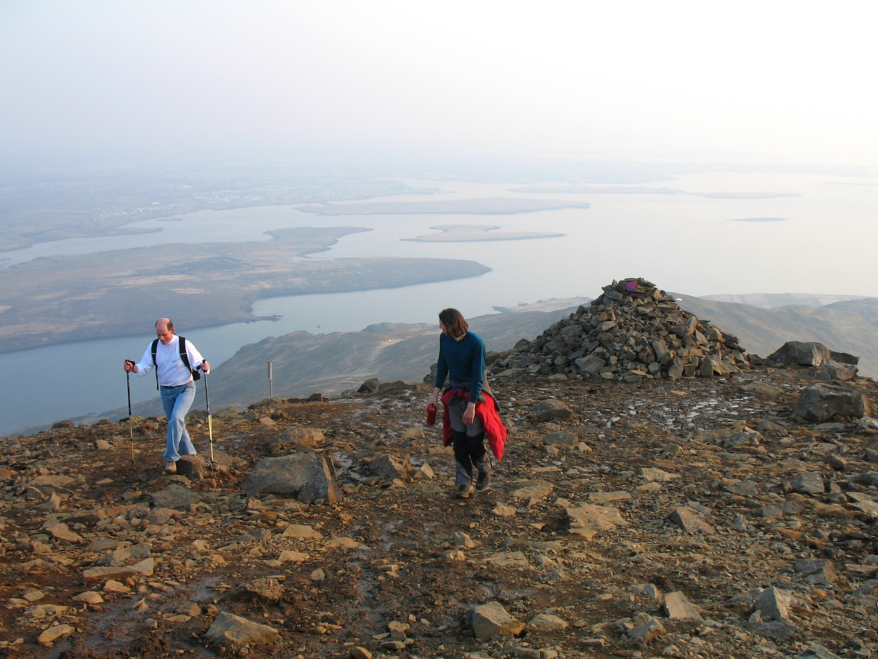 Dale and Steve arrive at the summit, Rekjavík can be seen in the background through the haze.