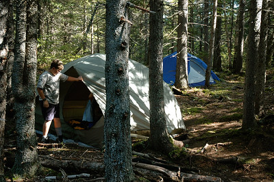 John helps set up tents at our camp near Thoreau Falls.