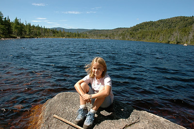 Mara enjoys a sunny rock on Ethan Pond, deep in NH White Mountains.