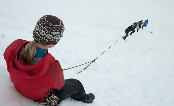 2011-07 AMTL1, Day 4 - Sandy Camp, Easton Glacier  Testing a snow anchor, can't remember if this was a fluke or a picket, though.  Erin is attached so it doesn't slingshot into everyone if it fails.  I only remember one or two anchors failing and it took at least 7 people pulling to make that happen.