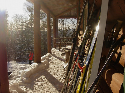 A line of skis on the porch of Great Bear cabin.