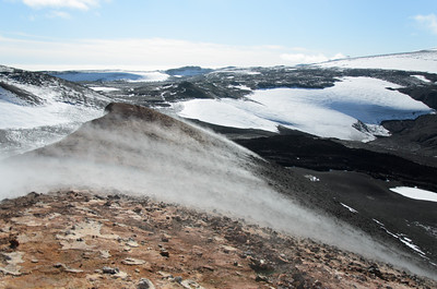 Steam coming off the flanks of the crater