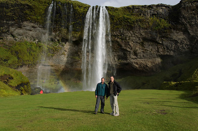 Madhu and Fred standing in front of Seljalandsfoss on our way to Skógar to begin our trek across Fimmvörðuháls