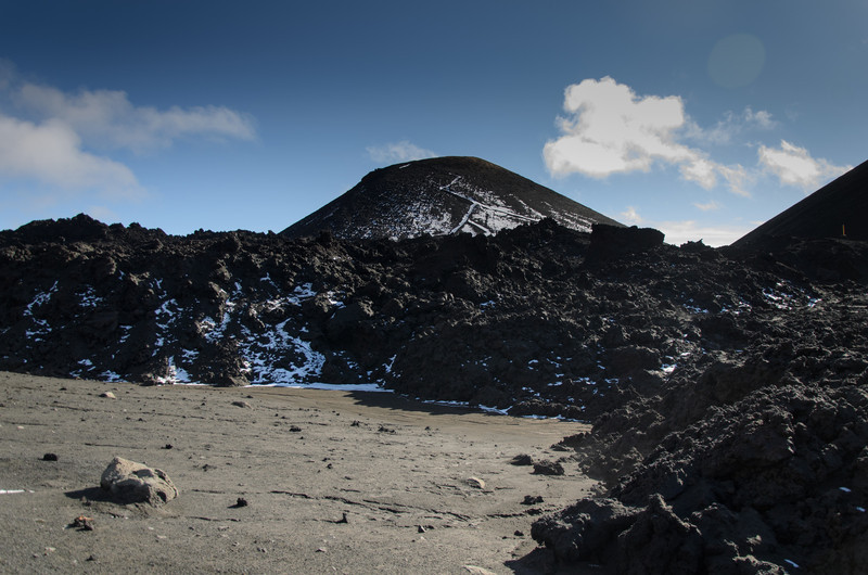 Looking back across the fresh lava field towards the crater