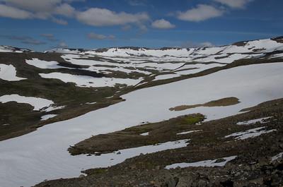 Karlstaðadalur fullur af snjó um miðjan júlí
