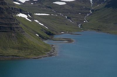 Skessulón og forvaðinn í Sópanda í Lónafirði. Farið er út fyrir hólmann