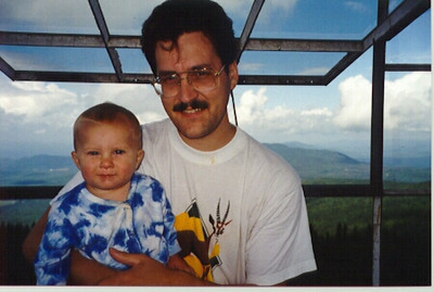 In contrast, here is John and Daddy in the same spot (Smarts Mountain fire tower, looking north), summer 1997.