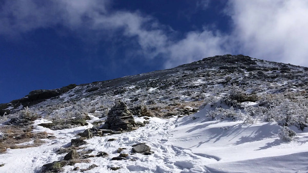 Video panorama - from the trail up to the (false) summit, around to Cannon Mountain. Note the wind!
