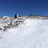 Approaching the summit, blown clear of loose snow, we the trail consists of rock, ice, and crusty old snow.