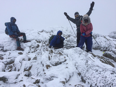 Lars, Lelia, David, and Andy (L to R) on the summit of Mount Moosilauke in a fierce wind and snowstorm.