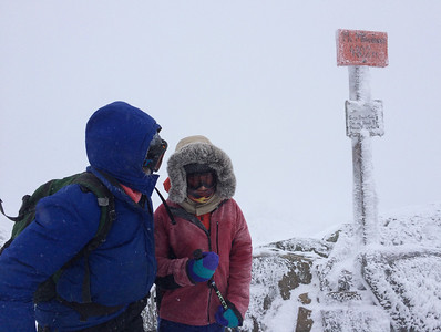 Lelia and Andy on the summit of Mount Moosilauke in a fierce wind and snowstorm.