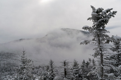 A freezing fog comes through Wind Gap, obscuring Mount Ethan Allen.