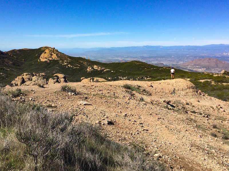 A hiker absorbs the view to the north, into the Simi Valley and beyond.