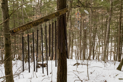 An unusual encounter on a forest trail - wind chimes made from copper pipe (left) and from kitchen utensils (right).