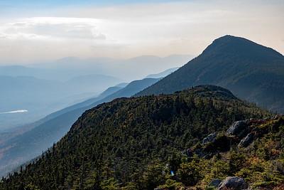 Hazy view of West Peak from Avery Peak, Bigelow Mountain, Maine.