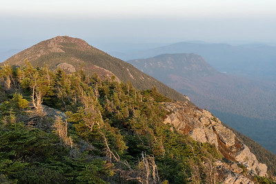 Late afternoon sun on Avery Peak and Little Bigelow Mountain, from West Peak, Bigelow Mountain, Maine.