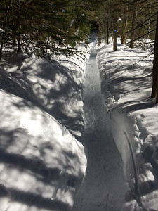 The Bradley Pond trail is a deep trench through deep snow.