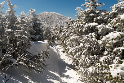 Deep snow on Moosilauke Ridge, with South Peak on the background; the drift at left was at least 5-6' above the trailbed at right.