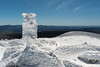A hiker descends the Gorge Brook trail from the summit of Mount Moosilauke, amid impressive rime ice.