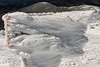 """The Moosilauke """"Carriage Road"""" sign is coated in rime ice, with South Peak beyond."""
