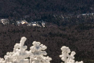 Moosilauke Ravine Lodge (under construction) from the ridge between the peaks - with rime-ice-frosted trees in foreground.