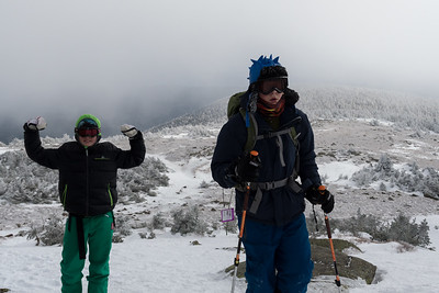 Benjamin and Andy reach the summit of Mount Moosilauke.