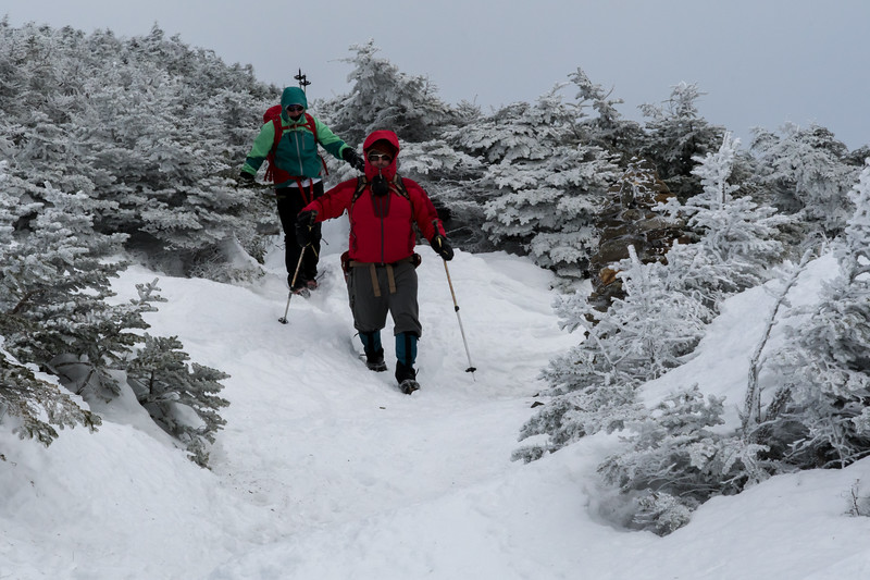 David Metsky and Monica Samolis descending from the summit of Mount Moosilauke