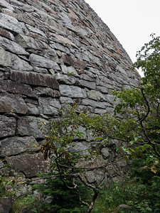 The trail hugs this huge stone wall - perhaps 30' high - for a few hundred feet.