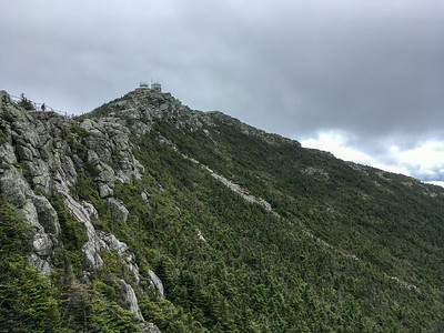 The clouds lift long enough for a view of the summit from the walkway leading from the parking area.