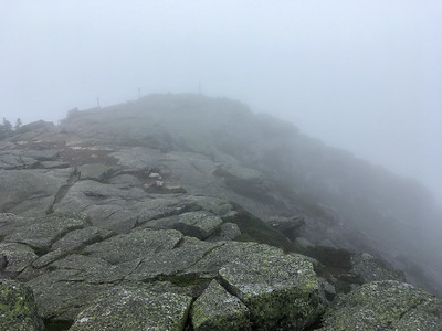 The summit of Whiteface Mountain is shrouded in cloud.