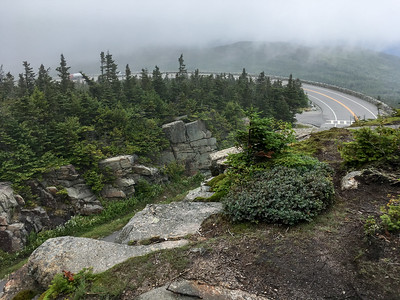 The trail proceeds on high cliffs above a hairpin turn on the Whiteface road.