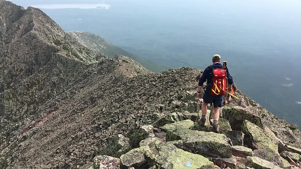 Video panorama of Jon traversing the Knife Edge to Pamola Peak, panning left over south basin and Chimney Pond, ending with view to Hamlin Peak.