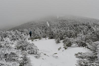 Lelia traverses the Moosilauke ridgeline as we depart the north peak.