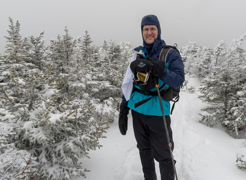 David pauses on the Moosilauke ridgeline, preparing to summit on this cloudy winter day.