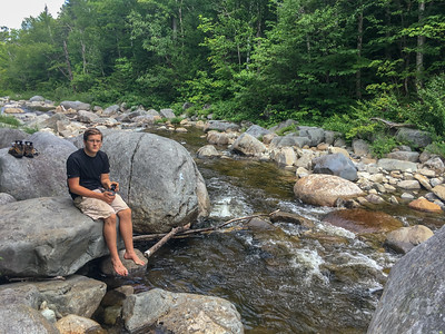 Andy ressts alongside the South Branch of the Carrabasset River, in Caribou Valley, where the A.T. crosses.