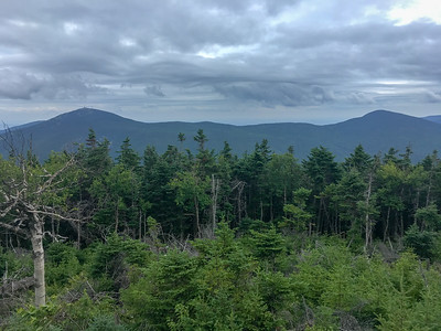 View of Sugarloaf and Spaulding from South Crocker Mountain, along the A.T. in Maine. The clouds are foreboding rain!