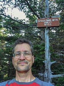 David at the summit of Mount Spaulding, along the A.T. in Maine. Apparently, recent surveys put the elevation above 4,000'.