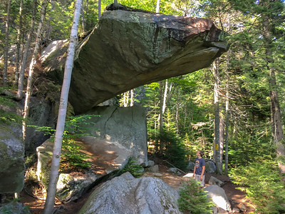 Andy inspects Piazza Rock, along the A.T. near Saddleback Mountain in Maine.