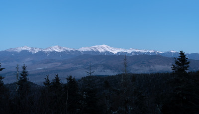The Presidential Range of the White Mountains, New Hampshire, in the moonlight after sunset, as view from Mount Martha.