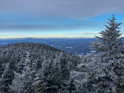 Distant view to the brilliant White Mountains: Moosilauke, Franconia, and Presidentials.