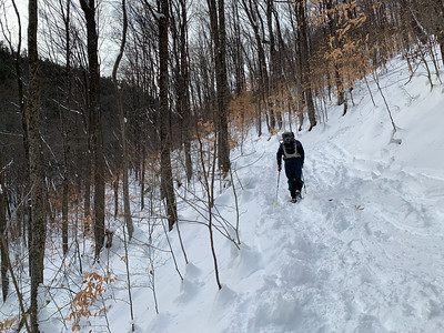 Andy hiking up Mount Ascutney on a snowy winter day.