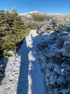 Mount Moosilauke from the ridgeline; my long shadow highlights the low sun, even in early afternoon.