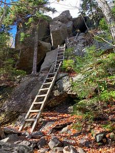Ladders climb the cliffs to Mt. Morgan.