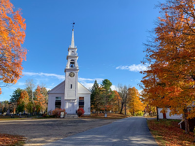 Autumn colors near a church in Center Sandwich, NH.
