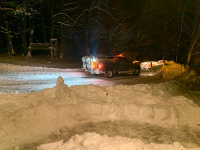 The snowplow clears our driveway.